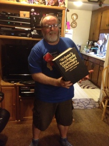 Holding the dictionary two-handed