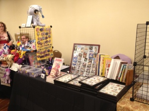 Ponies, Disney pins, and other merchandise on our table