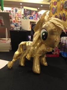 A gold lamé rag doll pony