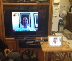 iPad connected to TV to show facetime on large screen.