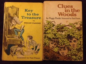 Hardcover copies of two books.