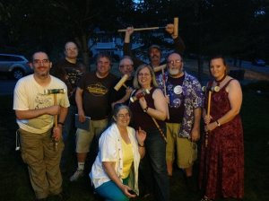 Nine people posing with croquet mallets.
