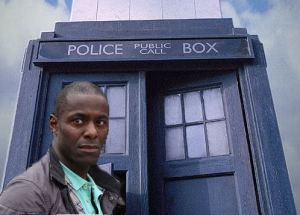 Acto Paterson Joseph standing in front of the Tardis.