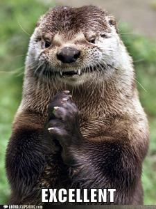 Close up of otter appearing to smile while holding his paws together.