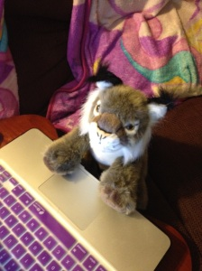 My lynx plushy seated at my laptop.