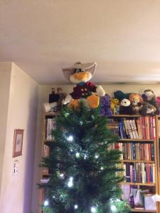 My Darkwing Duck toy atop the not yet decorated tree.