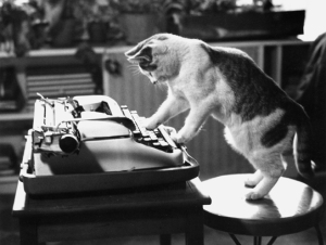Cat with a manual typewriter.