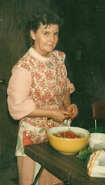 Grandma cutting up some tomatoes.