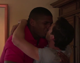 Michael Sam kissing his boyfriend when they get the news.