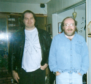 Gene and Michael standing in a living room.