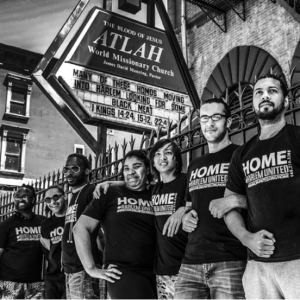Harlem United's H.O.M.E Program Group taking a stand in front of the notorious Atlah church sign.