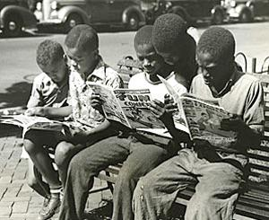 A few weeks back when one of the serious news sites reported that people of color have only recently become involved in reading comics and science fiction, Arab-American past Hugo-nominated science fiction author Saladin Ahmed shared this historical photograph showing a bunch of African-American kids reading comics in the 1940s.