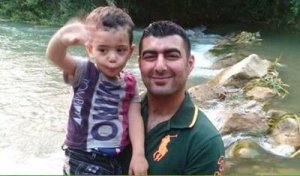 This is Adel Termos pictured with one of his children.  Mr. Termos sacrificed himself by tackling a suicide bomber in Beirut on Thursday.