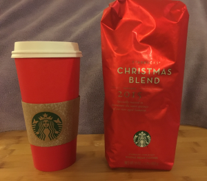 A bag of Starbucks Christmas blend and the cup from my most recent latte, both purchased Saturday.