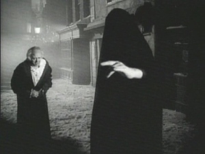 "Alistair Sim meets the Ghost of Christmas Yet To Come in the 1951 ""Scrooge."""