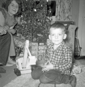 Christmas at my Grandma's, age 4. There are a surprising number of pictures of me with that Tonka steam shovel in later years.