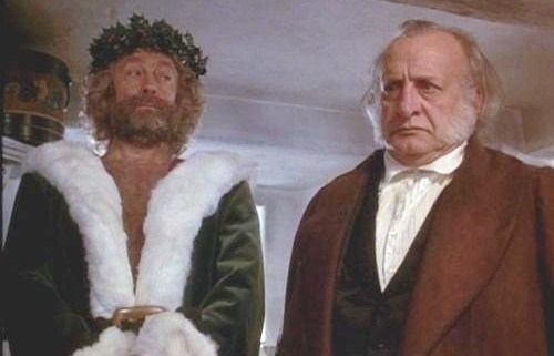 "Edward Woodward as the Ghost of Christmas Present and George C. Scott as Ebenezer Scrooge from the 1984 CBS ""A Christmas Carol."""