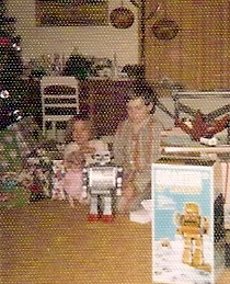 My sister and I with our presents Christmas morning at my paternal grandparents; house.