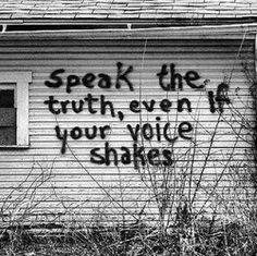 """Spray painted words on the walls of a house: """"Speak the truth, even if your voice shakes."""""""