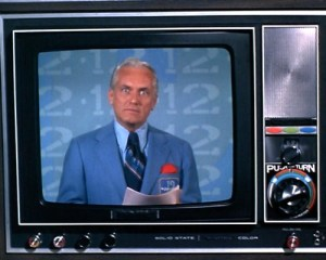 Ted Knight portraying fictional (and bumbling) news anchor, Ted Baxter, on the Mary Tyler Moore Show.