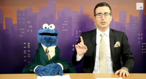 "John Oliver and the Cookie Monster presenting news on ""Last Week Tonight."""