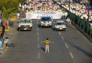 This photo of a kid single-handedly trying to keep 11,000 antigay protesters from marching went viral this week.