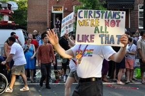 Protestors and counter protestors at a gay pride parade. © Patrick Carlson (https://www.flickr.com/photos/48018335@N06/)