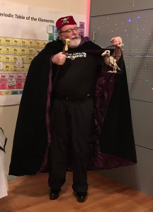 Myself as a Social Justice Necromancer. You can't see the purple tassel from from hat, nor that I'm wearing 6-inch platform pumps. The bird was not one of my props, it was a party decoration, but everyone wanted me to pose with it. (Click to embiggen)