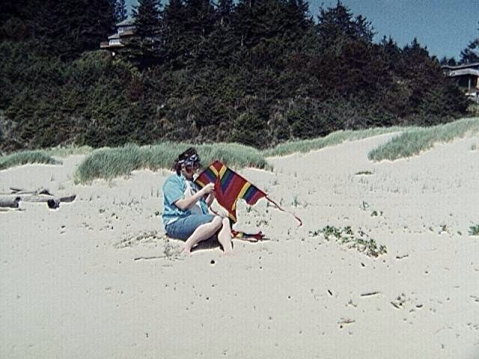 "My friend Kristin recently sent me this picture saying, ""How I like to remember Ray."" This was a trip we all took to the beach. He's prepping his kite for launch."
