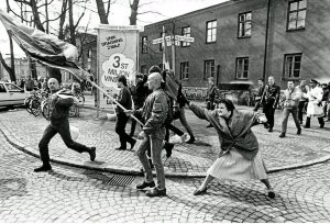 Danuta Danielsson, a woman of Polish and Jewish descent, caught on camera in 1985 by photographer Hans Runesson, hitting a marching neo-Nazi in the the head with her handbag on the streets of Växjö, Sweden.