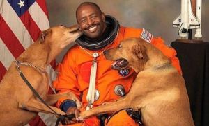 Retired astronaut Leland Melvin brought his rescue dogs, Jake and Scout to be in his official portrait. © 2009 NASA