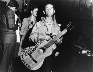 Guthrie put the slogan on his guitars in many different ways over the years (Photo by Lester Balog)