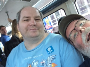 This was taken before our friend Julie tried to teach me better selfie technique. Riding the monorail during a long weekend of touristy things when Michael's brother and wife visited us somewhat recently. I don't know why he puts up with my silliness.