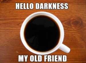 "Cup of coffee with the phrase, ""Hello Darkness, my old friend."""