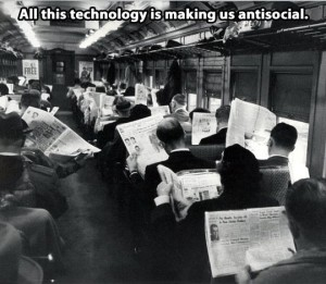 """Photo of commuters on a train in the 1960s, everyone reading a newspaper with the caption: """"All this technology is making us anti-social."""""""