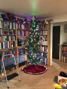 Our artificial tree is almost as tall as the ceilings in the new house. Here was a midway point in the process... © 2017 Gene Breshears