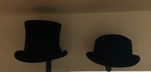 One of my husband's current art projects is setting up some of our many hats in displays around the new house. These are the hats we wore the day we were married. And yeah, I get that lump in my throat and tear up every time I look up at them. Tears of joy.