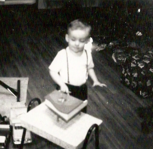Three-year-old me at Christmas with my toy piano.