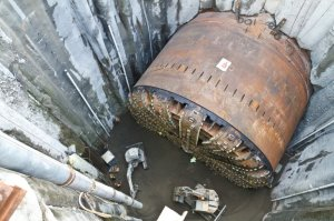 This is what the tunnel boring machine actually looked like during the second big delay, when they had to dig a big pit down to it to replace the big broken rotary head in 2015. (photo © WSDOT)