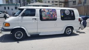 One of many photos of the van owned by the bombing suspect. It is covered in racist, misogynist, pro-Trump stickers, including my images of prominent Democrats with gun sight crosshairs superimposed.