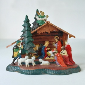 For many years we had a tiny plastic nativity like this, which sometimes Mom would hang on the tree as an ornament.