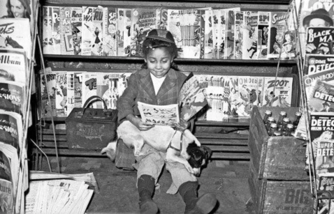 Look at this African-American girl gleefully reading comic books in the 1940s...
