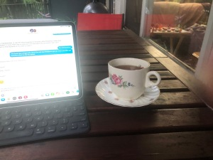 My new Sunday ritual involves tea and the iPad on the veranda.