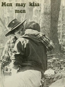 "Vintage photo of two men sitting in a forest and kissing. ""Men May Kiss Men"""