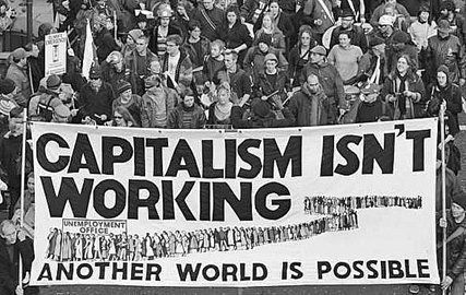 "Historical photo depicting a crowd a protestors during the Great Depression holding a sign that reads ""Capitalism isn't working. Another world is possible."""