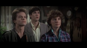 """Movie still: (l to r) """"Evil Ed"""", Charley, and Amy, as portrayed by Stephen Geoffreys, William Ragsdale, and Amanda Bearse."""