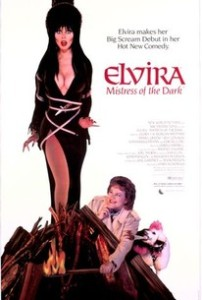 Cover of the DVD release of Elvira, Mistress of the Dark, showing Elvira tied to a stake, while city councilwoman Chastiity Pariah strikes a match.