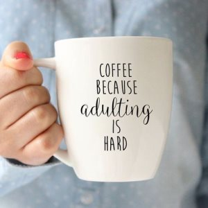"Cup which reads ""COFFEE because adulting is hard."""